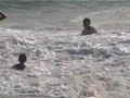 Virginia Beach travel: Playing in the surf at Sandbridge Beach.