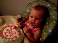 layla eating her first birthday cake.