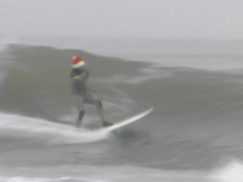 Funny Santa Surfing and ripping a few waves