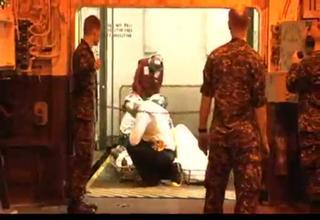 Haitian earthquake survivors brough aboard USS Carl Vinson (CVN 70) for medical treatment