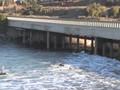 Surfing under ther bridge