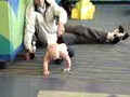 Little Boy Pulled by Father