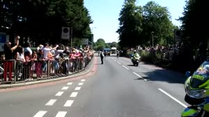 Patrick Stewart carries the Olympic Torch through Croydon