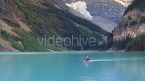 Couple Canoe Across Alpine Lake - 2 Versions